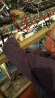 David, with cutters to the fore, trims back cable ties from tidied cable runs & works on the labelling system...