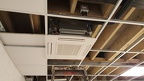 With the air-conditioning units in, surrounding ceiling tiles start to be installed, having been cut to size accordingly.